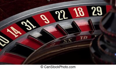 Roulette wheel starts running and stops