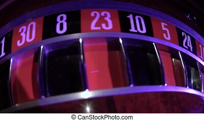 Roulette wheel starts running with white ball. Zero. Close up