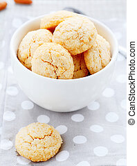 round almonds cookies in a bowl,