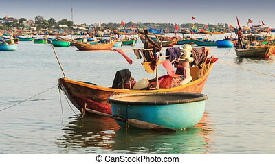 Round and Long Fishing Boats Float in Sea Bay in Vietnam