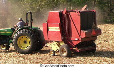 Round Baler in Action - Round baler finishes processing and...