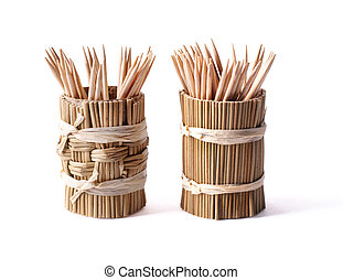 round bamboo box with toothpicks isolated on white background,