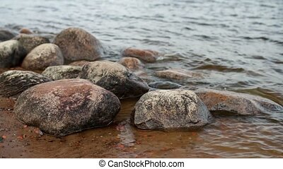Round Boulders on the riverbank - Round Boulders on the...
