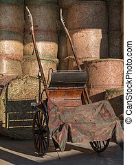 Round Bundles of Haystacks and Wooden Cart in Countryside Location