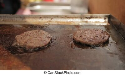 Round burger cutlets roasting in oil - Appetizing round...