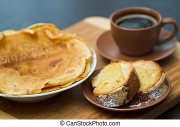 Round cake slice with pancake and coffee. Traditional cuisine.