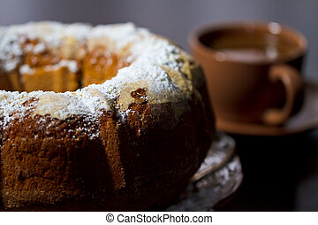 Round cake with sugar top and coffee. Traditional cuisine.