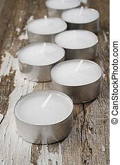 round candle on wooden background