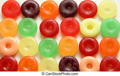 Round Candy - Colorful round candies with hole in middle on...
