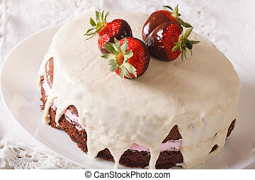 Round chocolate cake with strawberries close-up on a dish. horizontal
