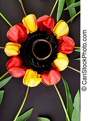 Round circle red and yellow tulips and cup of coffee
