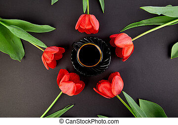 Round circle red tulips and cup of coffee
