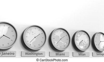 Round clock showing Miami, USA time within world time zones....