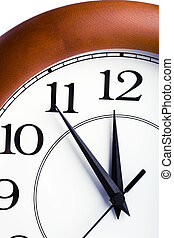 round clock showing time about twelve isolated