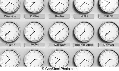 Round clock showing Warsaw, Poland time within world time...