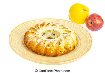 Round delicious biscuit cake with fruit, raisins and dried cranberries. Homemade dessert, baking