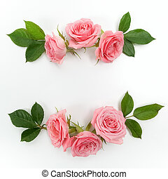Round frame made of pink roses, green leaves, branches, floral pattern on white background. Flat lay, top view.