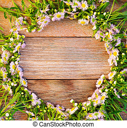 Round frame of chamomile pharmacy on wooden retro background with space for text, top view