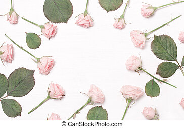 round frame of pink flowers on white background