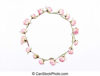 round frame of pink  flowers on white background.