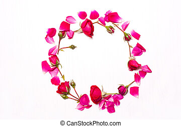 round frame of pink,red flowers on white background.