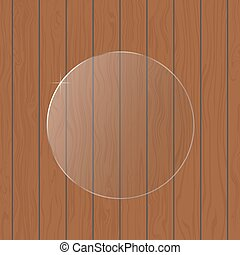 Round glass on a wooden background.