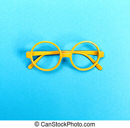Round glasses on a bright blue background