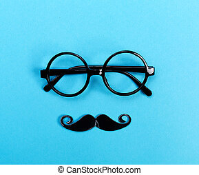 Round glasses on a bright blue background - A pair of round...