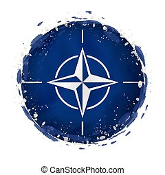 Round grunge flag of Nato with splashes in flag color.