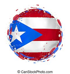 Round grunge flag of Puerto Rico with splashes in flag color.
