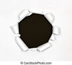 Round hole in paper on black background inside