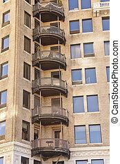 Round Iron Balconies on Old Brick Apartments