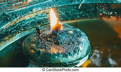 Round iron candle with eternal fire in special house....