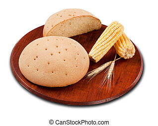 Round loaf of corn bread close-up on a white background.