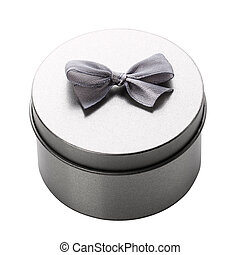 Round metal gift box on a white background.