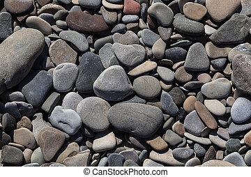 Round peeble stones background in close up