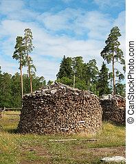 Round pile of firewood. A island Valaam