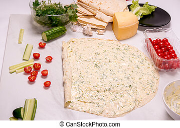 Round pita bread with cheese, cucumber, herbs, mayonnaise.