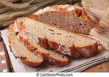 round rye bread - Sliced traditional round rye bread