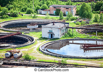 Round settlers at sewage treatment plant, aerial view