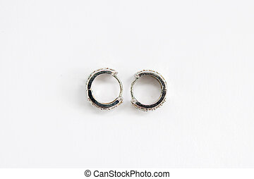 round silver earrings on a white background