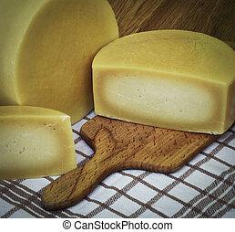Round sliced hard cheese