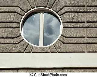 Round small window in Italian city