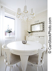 Round table in classic living room, vertical
