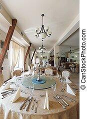 Round table in elegant restaurant