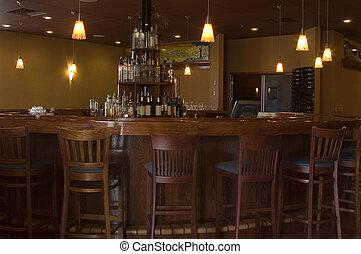 Round Teak Bar - A round teak bar with rich wooden bar...