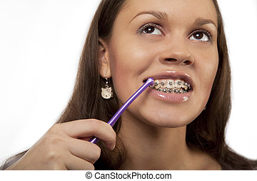 round toothbrush - girl cleaning teeth with bracket system...
