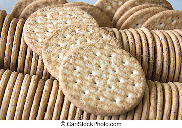 Round Whole Wheat Crackers Stacked in Glass Container Closeup Macro