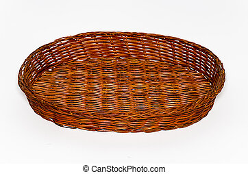 Round wicker basket of brown color on a white background