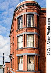Round Windows in Old Brick Building